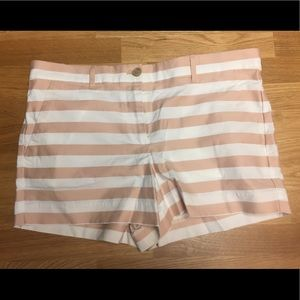 Pink and white striped shorts.